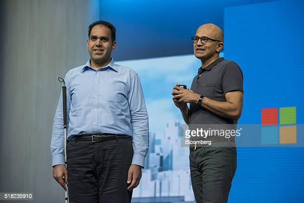 Visually impaired Seqib Shaikah a developer with Microsoft Corp left listens as Satya Nadella chief executive officer of Microsoft Corp speaks during...