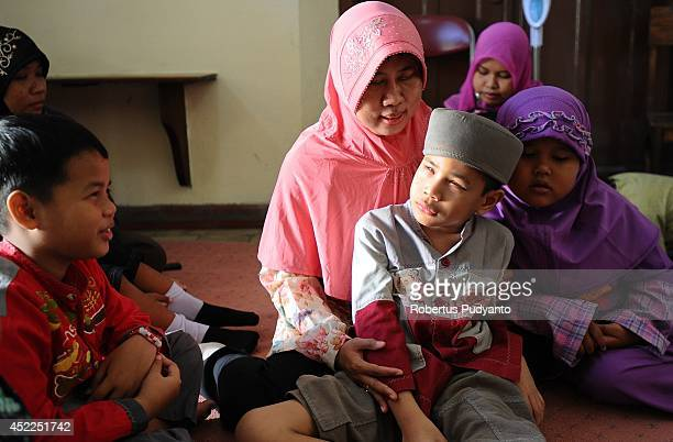 Visually impaired students attend to Ramadan class at The Foundation for The Education of Blind Children to read the Braille Quran and praying on...