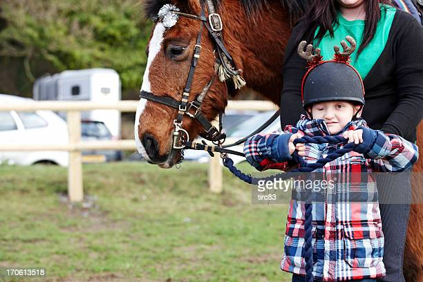 Visually impaired youngster with horse portrait