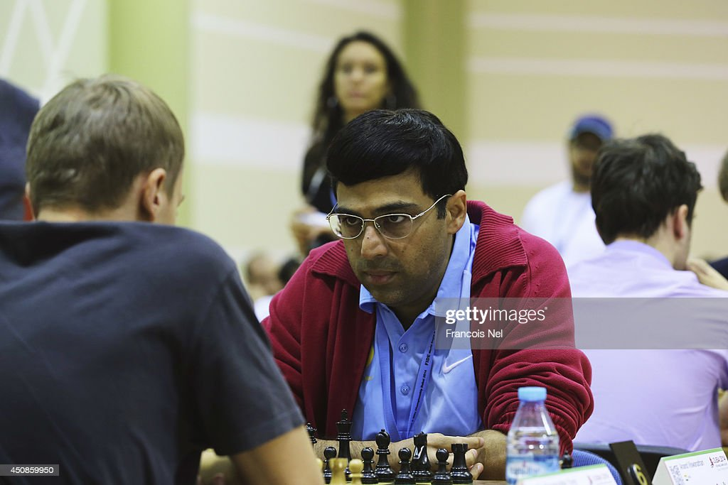 <a gi-track='captionPersonalityLinkClicked' href=/galleries/search?phrase=Viswanathan+Anand&family=editorial&specificpeople=639502 ng-click='$event.stopPropagation()'>Viswanathan Anand</a> of India plays in the FIDE World Rapid & Blitz Chess Championships 2014 at Dubai Chess and Culture Club on June 19, 2014 in Dubai, United Arab Emirates.