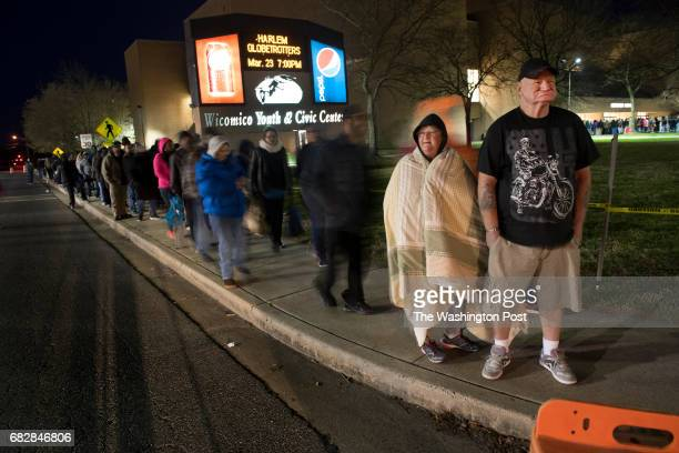 Vita Elliott age 63 and Edward Hall age 63 wait in belowfreezing temperatures with hundreds of others to get into the Eastern Shore Mission of Mercy...