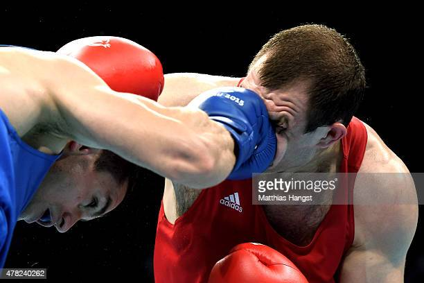 Vitali Bandarenka of Belarus and Xayula Musalov of Azerbaijan compete in the Men's Boxing Middleweight Quarter Final during day twelve of the Baku...