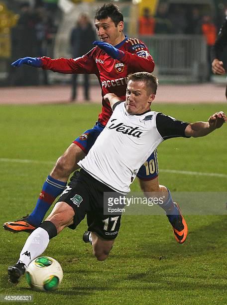 Vitali Kaleshin of FC Krasnodar Krasnodar in action against Alan Dzagoev of PFC CSKA Moscow during the Russian Football League Championship match...