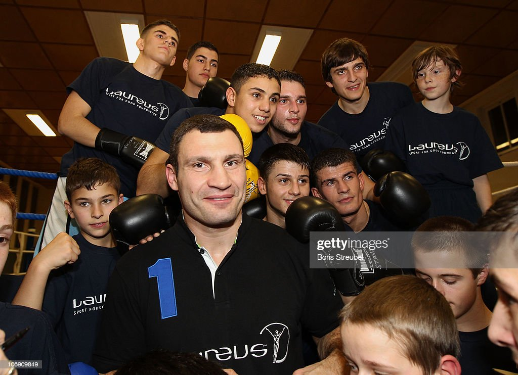 <a gi-track='captionPersonalityLinkClicked' href=/galleries/search?phrase=Vitali+Klitschko&family=editorial&specificpeople=206402 ng-click='$event.stopPropagation()'>Vitali Klitschko</a> and kids pose for a picture during the Laureus Sport For Good Project Visit at SV Stahl Schoeneweide on November 16, 2010 in Berlin, Germany.