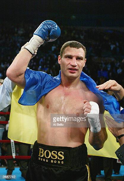 Vitali Klitschko celebrates after defeating Kirk Johnson during their heavyweight bout on December 6 2003 at Madison Square Garden in New York City...