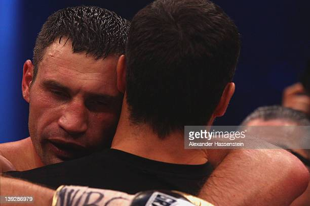 Vitali Klitschko of Ukraine celebrates with his brother Wladimir Klitschko after winning his WBC Heavyweight World Championship fight against Dereck...