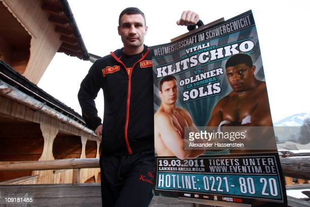 Vitali Klitschko of Ukraine pose with the official fight poster on February 16 2011 in Going Austria The WBC Heavyweight World Championship fight...