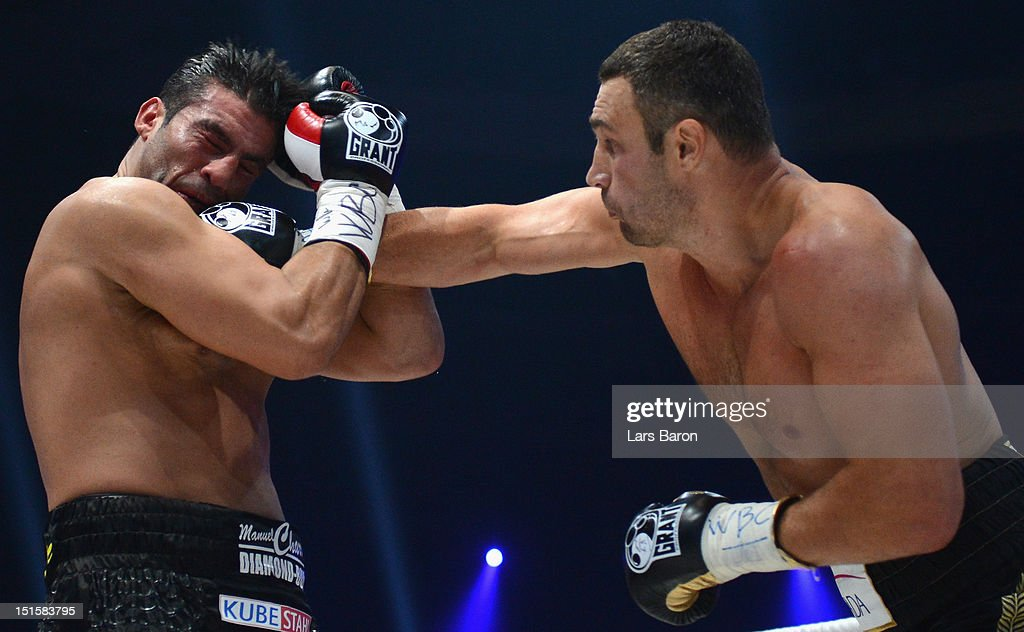 <a gi-track='captionPersonalityLinkClicked' href=/galleries/search?phrase=Vitali+Klitschko&family=editorial&specificpeople=206402 ng-click='$event.stopPropagation()'>Vitali Klitschko</a> of Ukraine punshes Manuel Charr of Germany during the WBC-heavy weight title fight between <a gi-track='captionPersonalityLinkClicked' href=/galleries/search?phrase=Vitali+Klitschko&family=editorial&specificpeople=206402 ng-click='$event.stopPropagation()'>Vitali Klitschko</a> of Ukraine and Manuel Charr of Germany at Olimpiyskiy Arena on September 8, 2012 in Moscow, Russia.