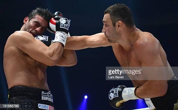 Vitali Klitschko of Ukraine punshes Manuel Charr of Germany during the WBCheavy weight title fight between Vitali Klitschko of Ukraine and Manuel...