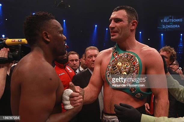 Vitali Klitschko of Ukraine talks to Dereck Chisora of Great Britain after their WBC Heavyweight World Championship fight at Olympia Halle on...