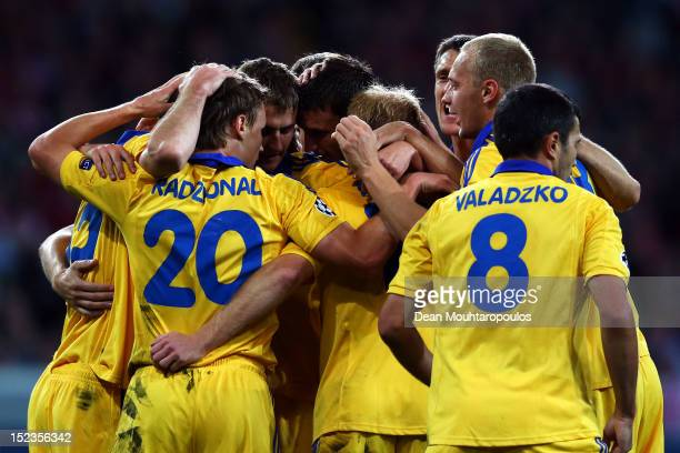 Vitali Rodionov of BATE is congratulated by team mates after he scores his teams second goal of the game during the Group F UEFA Champions League...