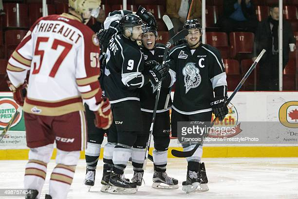 Vitalii Abramov of the Gatineau Olympiques celebrates his second period goal with teammates Yan Pavel Laplante and Alexandre Carrier as Francis...