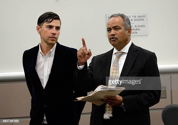 Vitalii Sediuk and lawyer Anthony Willoughby appear at Los Angeles Superior Court House on May 30 2014 in Los Angeles California Sediuk was arrested...