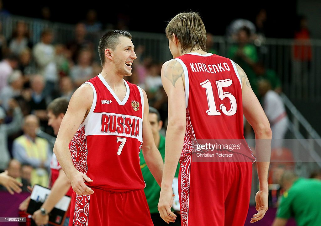 Vitaliy Fridzon #7 of Russia celebrates with teammate Andrey Kirilenko #15 after hitting a three-point shot to win the game 75-74 over Brazil during the Men's Basketball Preliminary Round match on Day 6 of the London 2012 Olympic Games at Basketball Arena on August 2, 2012 in London, England.