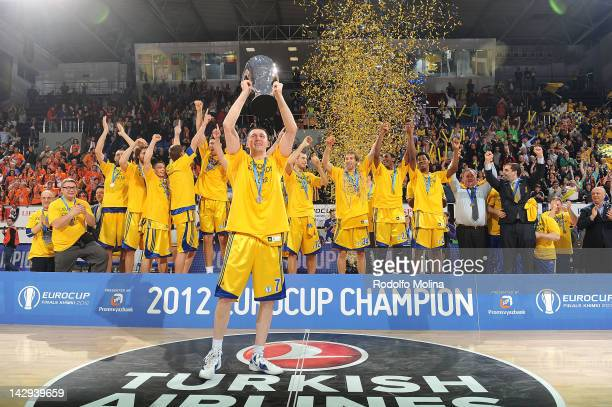 Vitaly Fridzon #7 of BC Khimki Moscow Region celebrates with Champion Trophy during the 2012 Eurocup Basketball Champion Award Ceremony after the...