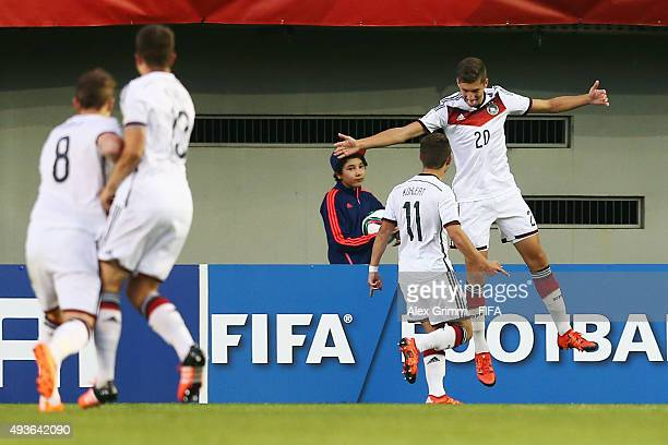 Vitaly Janelt of Germany celebrates his team's first goal with team mate Goekhan Guel during the FIFA U17 World Cup Chile 2015 Group C match between...
