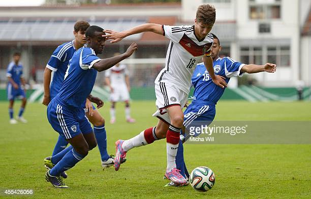 Vitaly Janelt of Germany is challenged by Ben Hamo Mor Mordechay and his teammates of Israel during the KOMM MIT tournament match between U17 Germany...