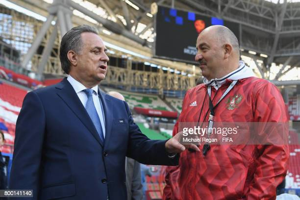 Vitaly Mutko speaks to Russia manager Stanislav Cherchesov during the Russia training session at Kazan Arena on June 23 2017 in Kazan Russia