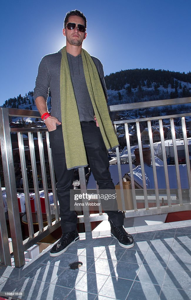 Vitaly Reznick, Associate Director of Fanology East Coast Sales from Miami, wearing Canali scarf, John Varvatos sweater, John Varvatos jeans and Converse for Varvatos shoes on January 20, 2013 on the streets of Park City, Utah.