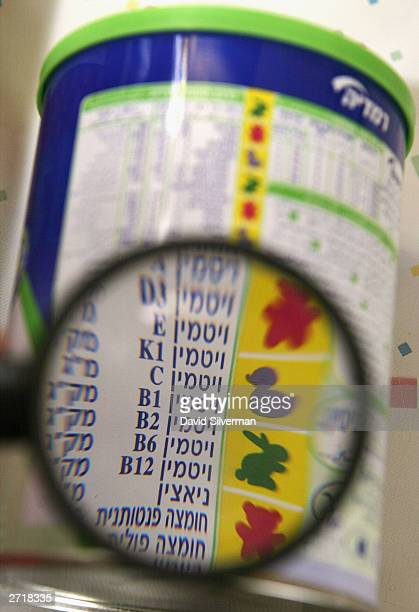 Vitamin B1 is seen listed on a can of Remedia soyabased infant formula in a baby's nursery November 11 2003 in the central Israel town of Hod...