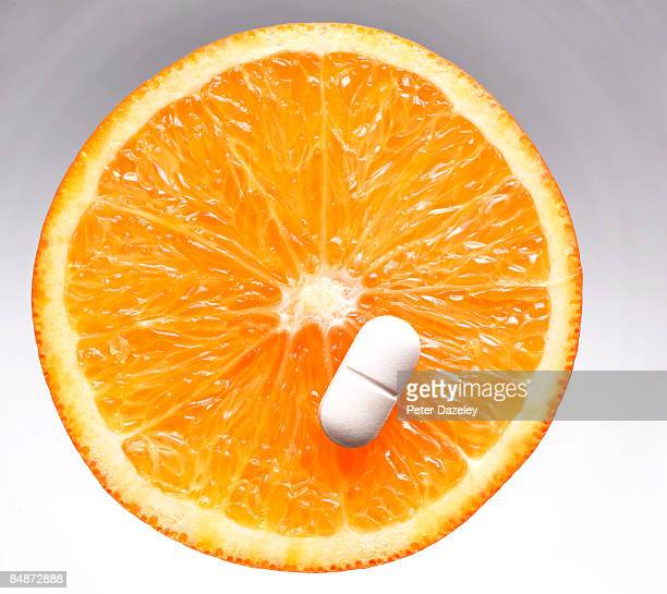 Vitamin C pill/ tablet on orange slice