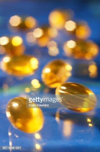 Vitamin E capsules, close-up (brightly lit) : Stock Photo