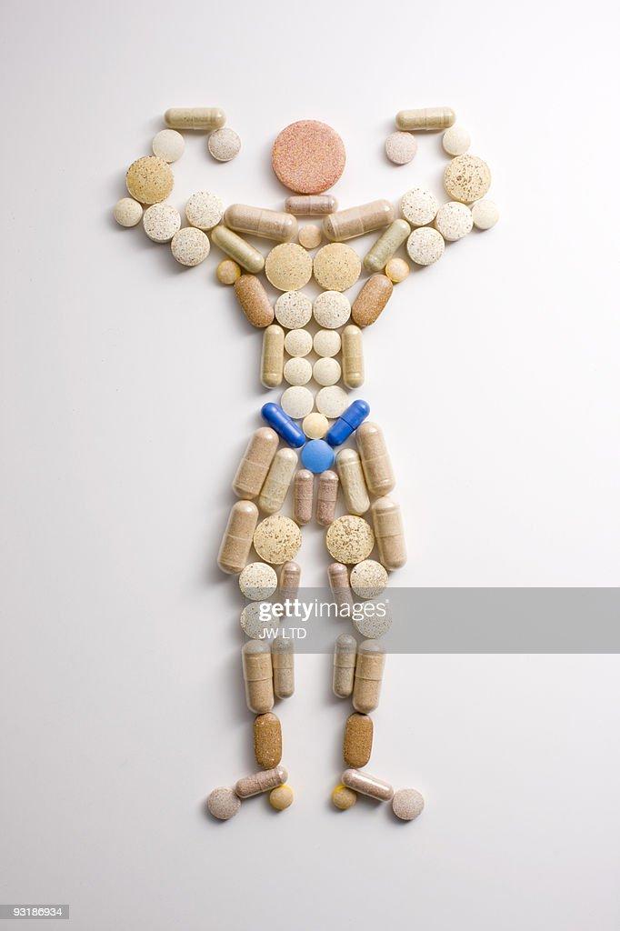 Vitamin pills in shape of man flexing muscles
