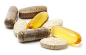 Natural vitamin supplements on white background