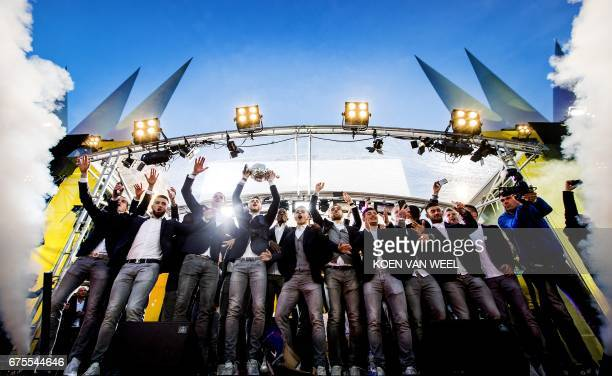 TOPSHOT Vitesse Arnhem players celebrate a day after winning the Dutch Cup final football match Aagainst AZ Alkmaar during a ceremony in front of the...