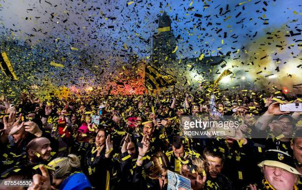 Vitesse Arnhem supporters celebrate with Vitesse Arnhem players during a ceremony in front of the City Hall of Arnhem on May 1 a day after Vitesse...
