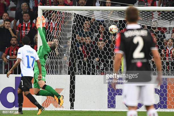 Vitesse's Dutch goalkeeper Remko Pasveer attempts to block Nice's French forward Alassane Plea goal during the UEFA Europa League group K football...