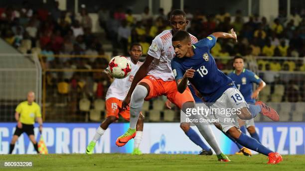 Vitinho of Brazil is challenged by Yacine Wa Massamba of Niger during the FIFA U17 World Cup India 2017 group C match between Niger and Brazil at...