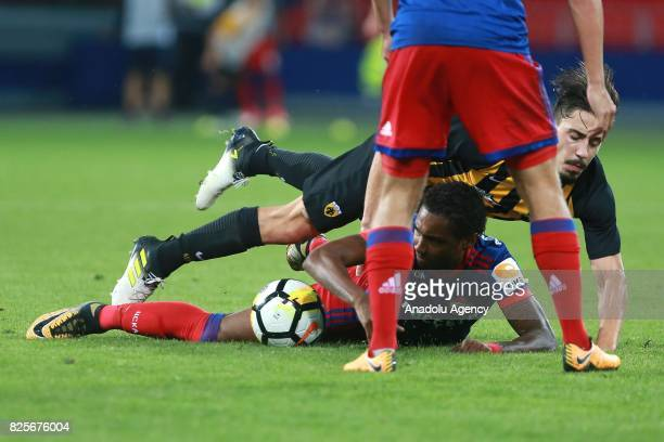 Vitinho of CSKA Moscow in action against Andre Simoes of AEK Athens during the UEFA Champions League 3rd Qualifying Round match between CSKA Moscow...