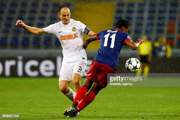 Vitinho of CSKA Moscow in action against Steve von Bergen of BSC Young Boys during a UEFA Champions League playoff match between CSKA Moscow and BSC...