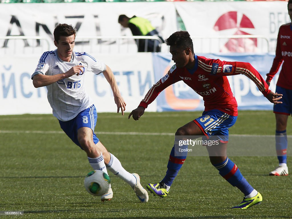 Vitinho of PFC CSKA Moscow is challenged by Artur Yusupov of FC Dinamo Moscow during the Russian Premier League match between PFC CSKA Moscow and FC Dinamo Moscow on October 6, 2013 in Moscow, Russia. (Photo b /Epsilon/Getty Images)Artur Yusupov;Vitinho