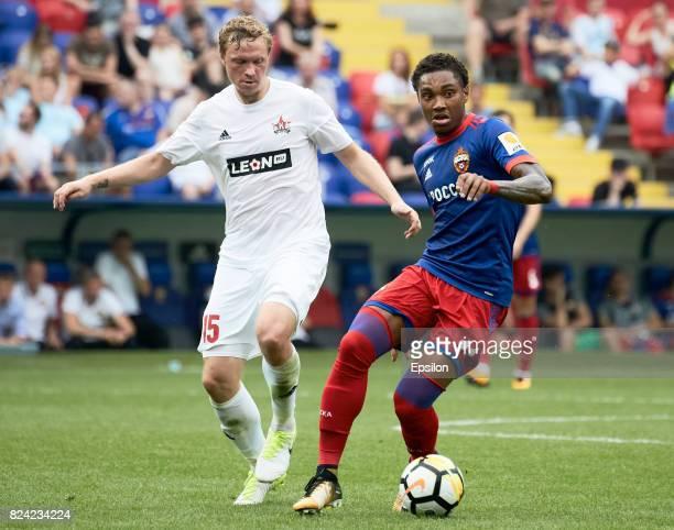 Vitinho of PFC CSKA Moscow vies for the ball with Yevgeni Balyaikin of FC SKA Khabsrovsk during the Russian Premier League match between PFC CSKA...