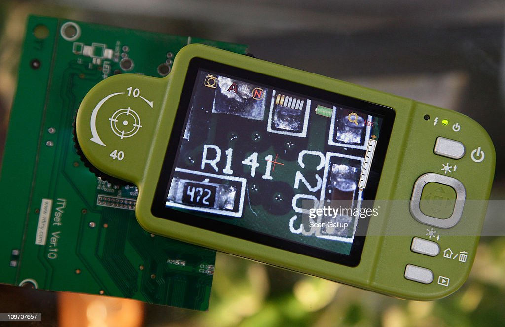 A Vitininy VT300 portable digital microscope and camera displays a detail from an electronic circuit board at the Microlinks Technology Corporation stand at the CeBIT technology trade fair on March 2, 2011 in Hanover, Germany. CeBIT 2011 will be open to the public from March 1-5.