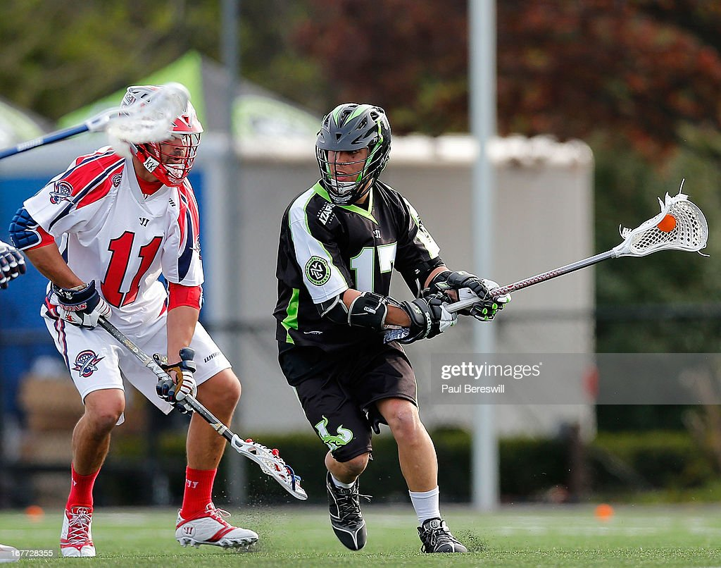 Vito DeMola #17 of the New York Lizzards is covered by Matt Smalley #11 of the Boston Cannons in the second half of a Major League Lacrosse game at James M. Shuart Stadium on April 28, 2013 in Hempstead, New York.