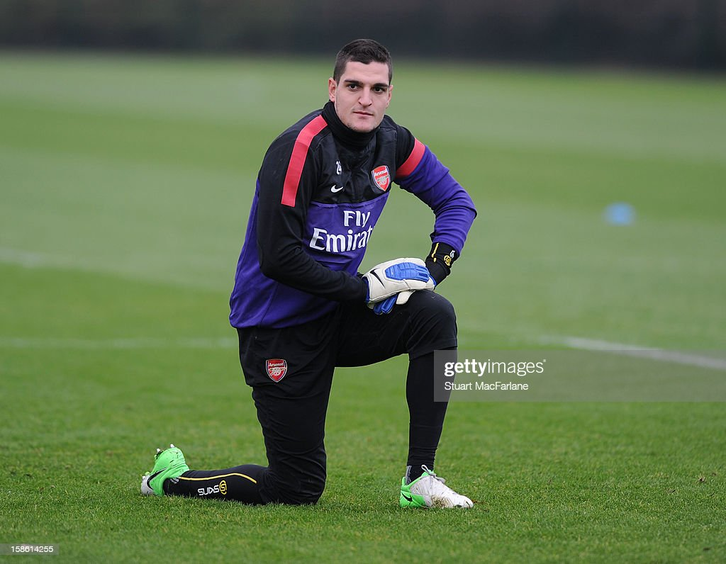 <a gi-track='captionPersonalityLinkClicked' href=/galleries/search?phrase=Vito+Mannone&family=editorial&specificpeople=4174200 ng-click='$event.stopPropagation()'>Vito Mannone</a> of Arsenal during a training session at London Colney on December 21, 2012 in St Albans, England.