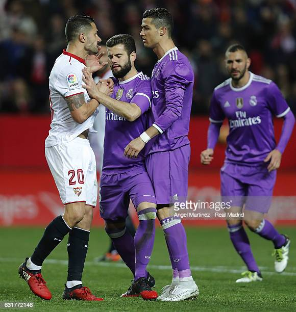 Vitolo of Sevilla argues with Nacho Fernandez and Cristiano Ronaldo of Real Madrid during the La Liga match between Sevilla and Real Madrid at...
