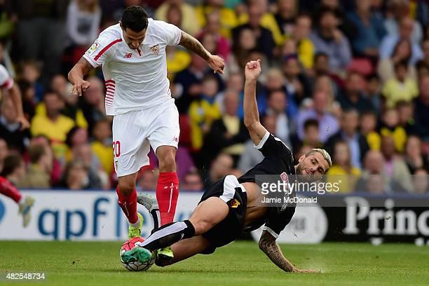 Vitolo of Sevilla battles with Valon Behrami of Watford during the pre season match beween Watford and Sevilla at Vicarage Road on July 31 2015 in...