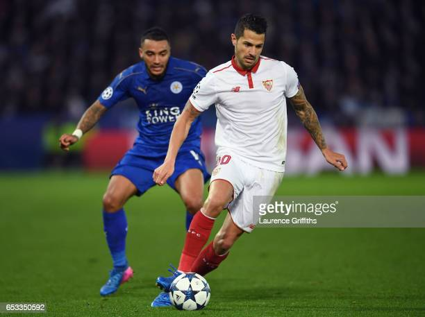 Vitolo of Sevilla is pursued by Danny Simpson of Leicester City during the UEFA Champions League Round of 16 second leg match between Leicester City...