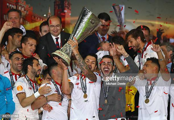 Vitolo of Sevilla lifts the Europa League trophy as players celebrate at the award ceremoy after the UEFA Europa League Final match between Liverpool...