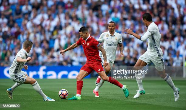 Vitolo of Sevilla surrounded by players of Real Madrid during the La Liga match between Real Madrid CF and Sevilla CF at Estadio Santiago Bernabeu on...