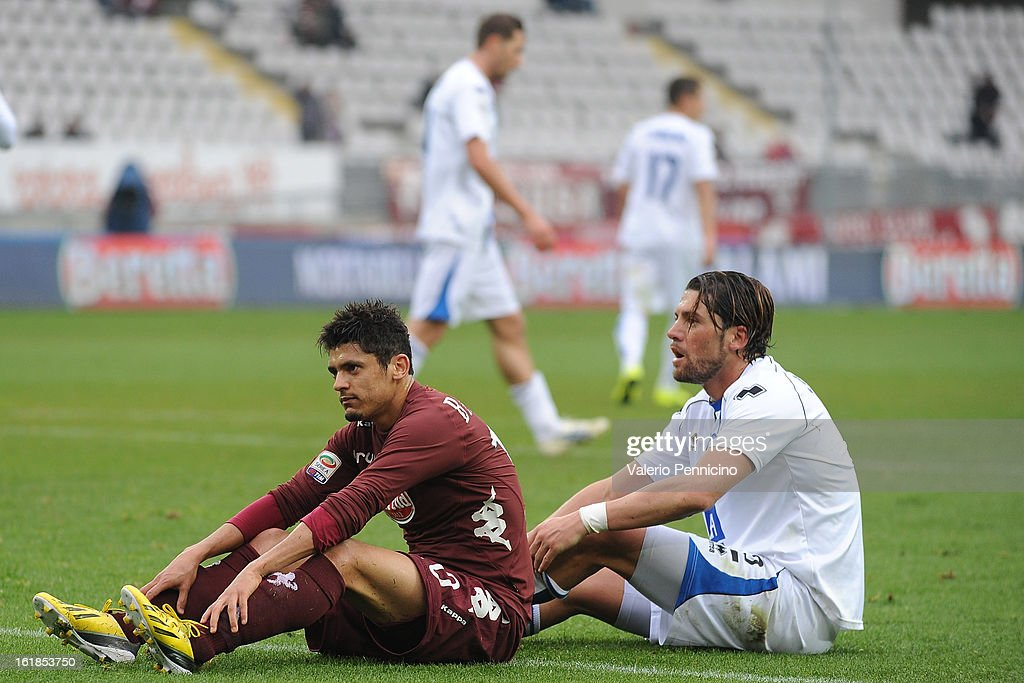 Vitor Barreto (L) of Torino FC looks dejected during the Serie A match between Torino FC and Atalanta BC at Stadio Olimpico di Torino on February 17, 2013 in Turin, Italy.