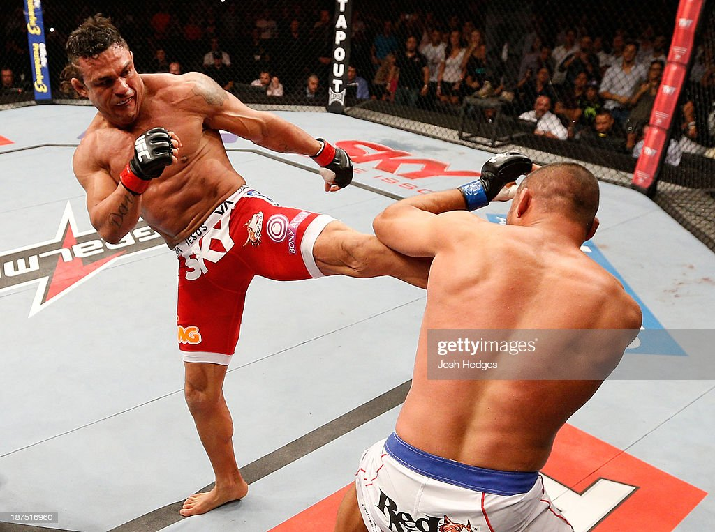 <a gi-track='captionPersonalityLinkClicked' href=/galleries/search?phrase=Vitor+Belfort&family=editorial&specificpeople=3433934 ng-click='$event.stopPropagation()'>Vitor Belfort</a> kicks Dan Henderson in their light heavyweight bout during the UFC event at Arena Goiania on November 9, 2013 in Goiania, Brazil.