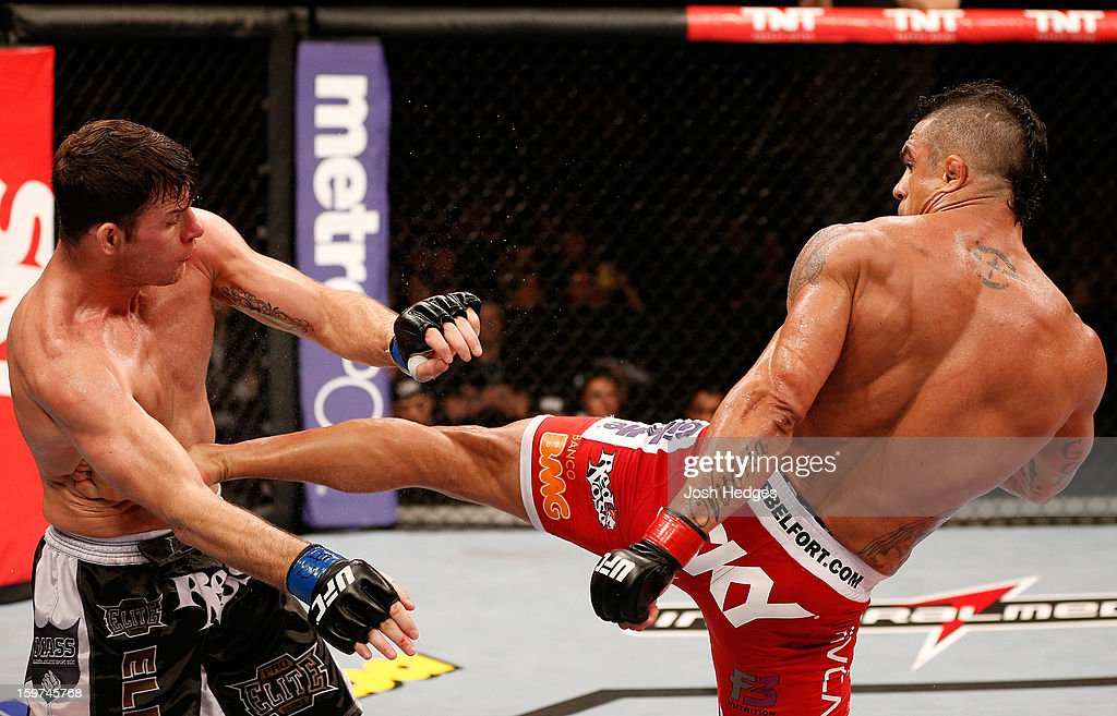 Vitor Belfort kicks Michael Bisping in their middleweight fight at the UFC on FX event on January 19, 2013 at Ibirapuera Gymnasium in Sao Paulo, Brazil.