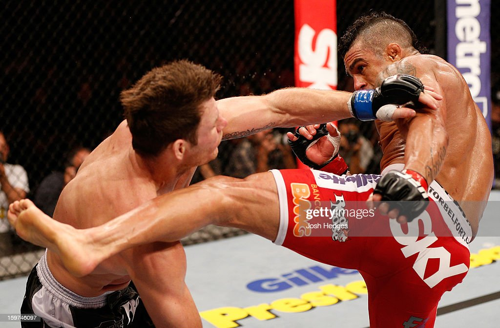 <a gi-track='captionPersonalityLinkClicked' href=/galleries/search?phrase=Vitor+Belfort&family=editorial&specificpeople=3433934 ng-click='$event.stopPropagation()'>Vitor Belfort</a> kicks <a gi-track='captionPersonalityLinkClicked' href=/galleries/search?phrase=Michael+Bisping&family=editorial&specificpeople=4165714 ng-click='$event.stopPropagation()'>Michael Bisping</a> in their middleweight fight at the UFC on FX event on January 19, 2013 at Ibirapuera Gymnasium in Sao Paulo, Brazil.