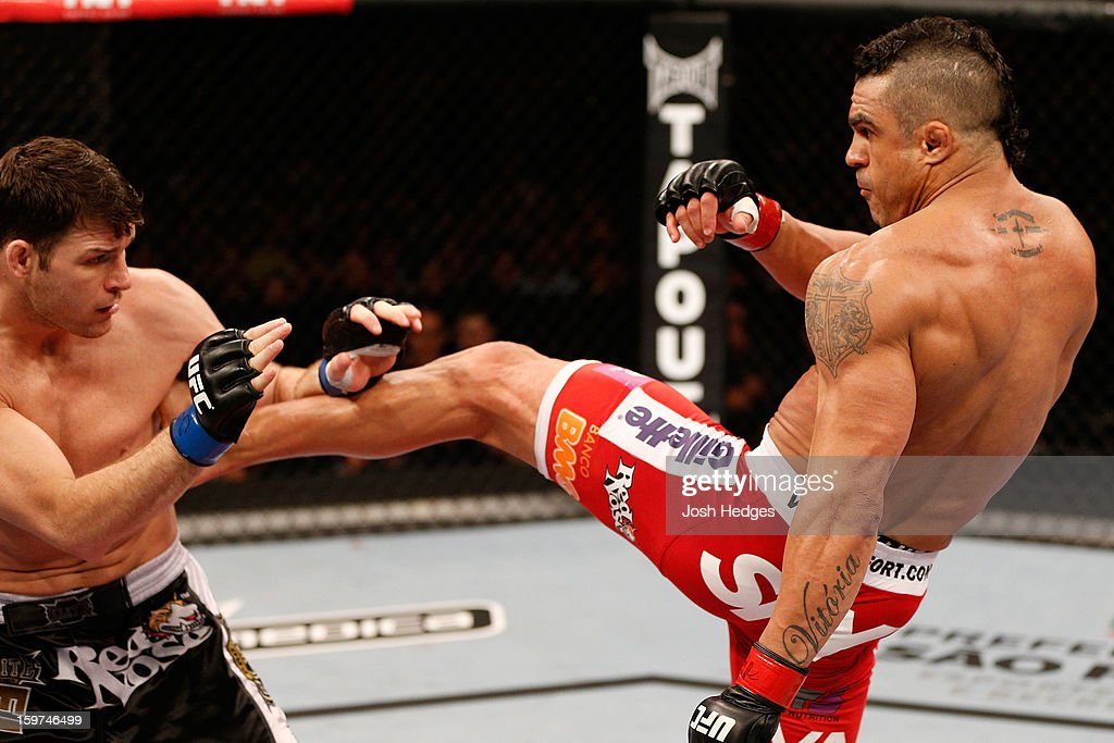 Vitor Belfort kicks <a gi-track='captionPersonalityLinkClicked' href=/galleries/search?phrase=Michael+Bisping&family=editorial&specificpeople=4165714 ng-click='$event.stopPropagation()'>Michael Bisping</a> in their middleweight fight at the UFC on FX event on January 19, 2013 at Ibirapuera Gymnasium in Sao Paulo, Brazil.