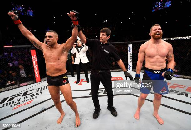 Vitor Belfort of Brazil celebrates after his unanimousdecision victory over Nate Marquardt in their middleweight bout during the UFC 212 event at...